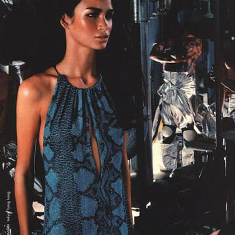 GUCCI by TOM FORD FROM THE SPRING SUMMER 2000 RUNWAY AND CAMPAIGN Sky blue, dark blue and black micro glass bead embroidered throughout • Python motif • Sky blue silk lining • Black leather halter neck • Clasp with gunmetal buckle signed Gucci •