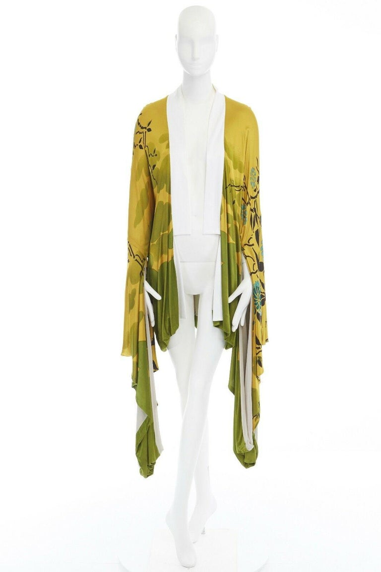 GUCCI BY TOM FORD  FROM THE SPRING SUMMER 2003 RUNWAY AND CAMPAIGN RAYON, VISCOSE • YELLOW BASE • ORIENTAL JAPANESE FLORAL BRUSHSTROKE PAINTING PRINT • WHITE KIMONO COLLAR • OPEN FRONT • WIDE DRAPED KIMONO SLEEVE • SHORTER BODY • FULLY LINED • MADE