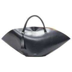 runway JIL SANDER Sombrero Large black smooth leather top handle flared tote bag
