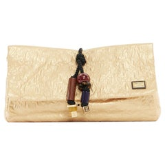runway LOUIS VUITTON SS09 Masai GM African Queen gold monogram tribal clutch bag