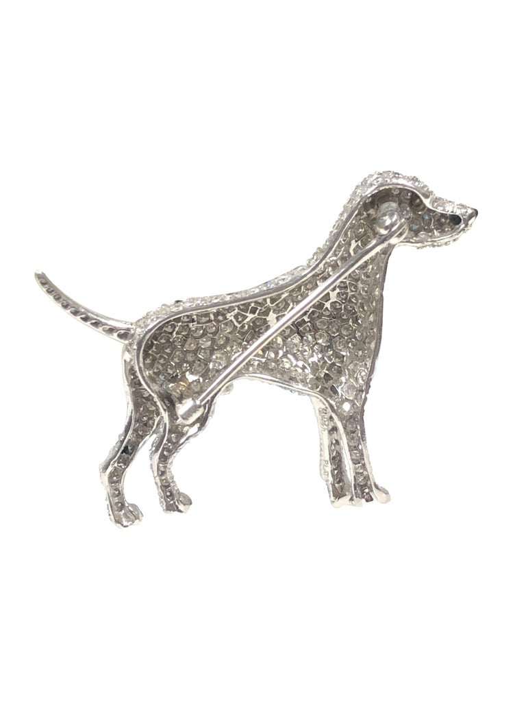 Circa 1940s Ruser Custom Ordered Dalmatian Platinum Diamond and Enamel Brooch, measuring 1 3/4 inches in length and 1 1/2 inches in height. Very fine Life like detailing, pave set with Diamonds totaling 3 Carats, Black enamel spots and a grey star