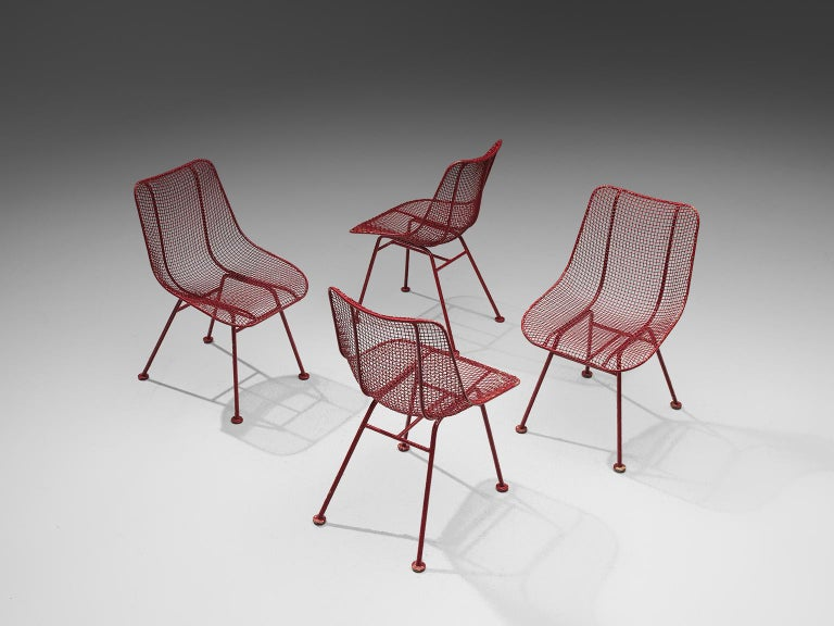 Russell Woodard 'Sculptura' patio chairs in wrought iron and red lacquer, United States, 1950s.   These 'Sculptura' patio chairs, which can be used as dining chairs as well, are in iron and woven steel. The intertwined steel creates a mesh and