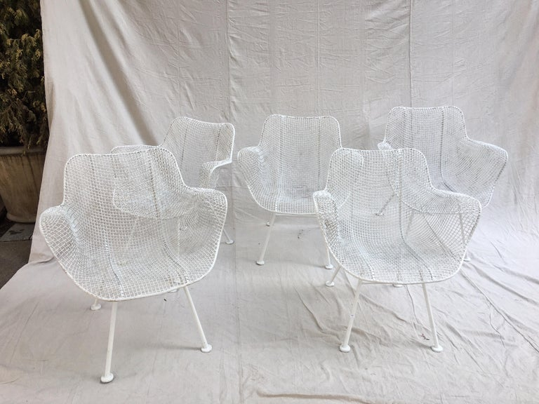 Set of 5 Russell Woodard armchairs in painted white.