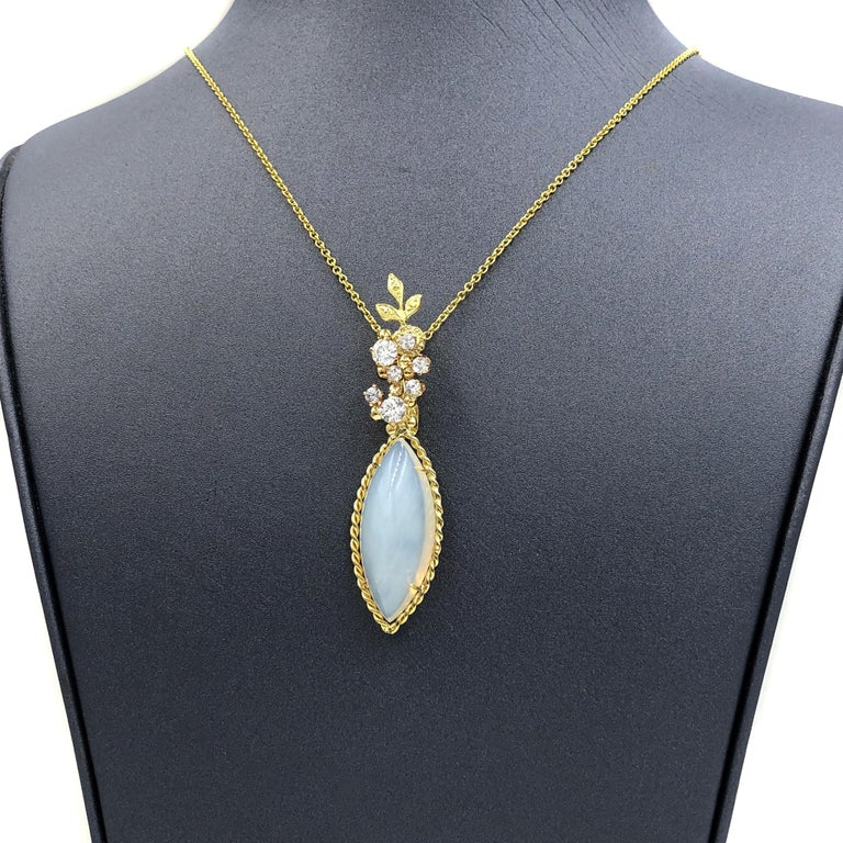 One of a Kind Necklace by acclaimed jewelry maker Russell Trusso featuring a spectacular milky marquise chalcedony cabochon with a subtle yellow-orange glows. The gem is wrapped in a handmade 18k yellow gold setting and sits beneath seven shimmering
