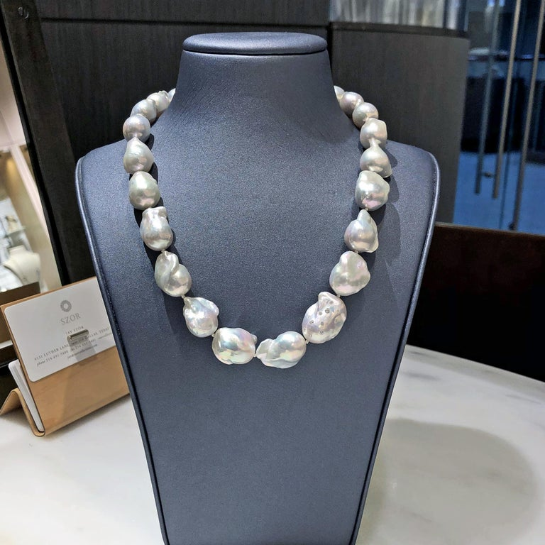 One of a Kind Pearl Necklace by acclaimed jewelry artist Russell Trusso featuring a highly-iridescent strand of extraordinary metallic white freshwater pearls, embellished with one of the designer's signature diamond-embedded pearls, set on each