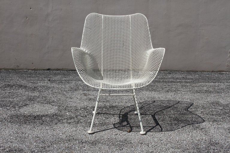 Mid-Century Modern Russell Woodard for Woodard mesh Sculptura high back lounge chair. Older white paint, shows some wear, loss to paint. Can be sandblasted, dipped in rust-prohibitor and painted for additional cost.