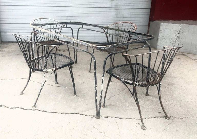 A somewhat rare group of 4 Russell Woodard Klismos chairs with a seldom seen table. The table dimensions are 60.5 inches long, 32.5 inches wide and is 29.5 inches tall. Chair dimensions are given below. Selling set as is, there is some paint loss,