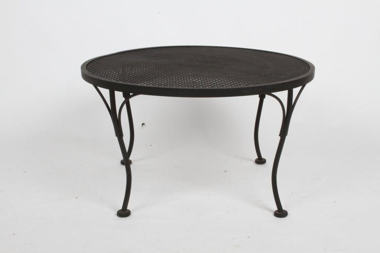Russell Woodard designed round coffee or side often see along side his Sculptura line chairs and settees. Shown in original matte black paint, from one owner estate, circa 1960s. Overall very nice condition, only minor scuffs to paint.