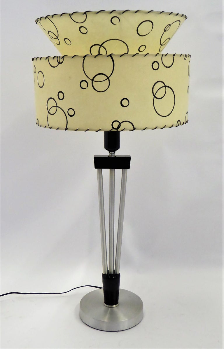 Mid-Century Modern  Russell Wright Spun Aluminum and Black Wood Table Lamp with Milk Glass Globe For Sale