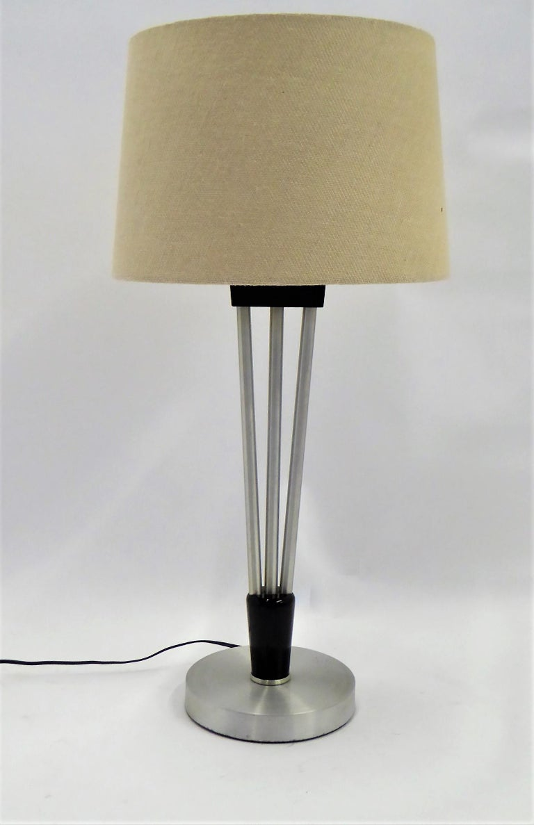 American  Russell Wright Spun Aluminum and Black Wood Table Lamp with Milk Glass Globe For Sale