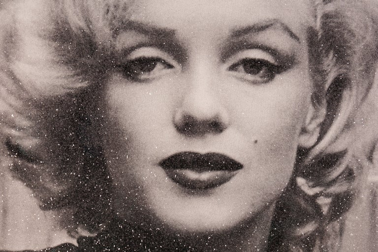 Marilyn with Diamond Dust (2019) by Russell Young has a superstar finish in classic black & white. Shimmering in the light with thousands of Diamond Dust flakes, this artwork shines with incredible depth and glow. This newly released series is