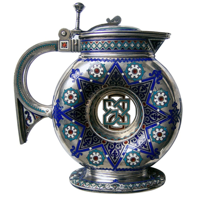 A fine Russian enamelled silver jug on stand by Khlebnikov of Moscow with gilded interior and reverse side of jug lid