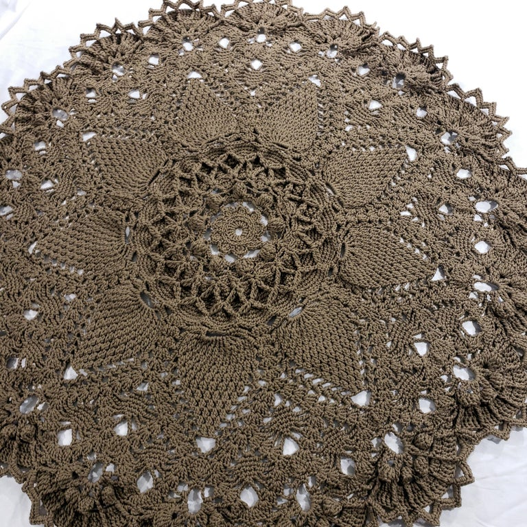 A crochet round rug with a traditional layered design, hand-made with classic Russian textile techniques.  This luxurious modern rug with a vintage charm will add an elegant dimension to any room!  ...  71 inches diameter Hand made in