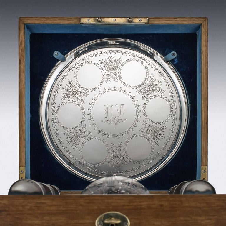 Antique 19th century Imperial Russian eight-piece solid silver and cut-glass vodka set, comprising: a circular tray engraved with Lillis of the valley and place circles, the baluster shaped bottle etched with flowers and leaves, collar and stopper