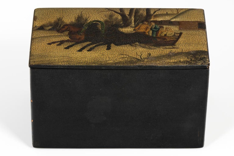 Lacquered Russian hand-painted tea box with a horse drawn sled theme, circa early 20th century.