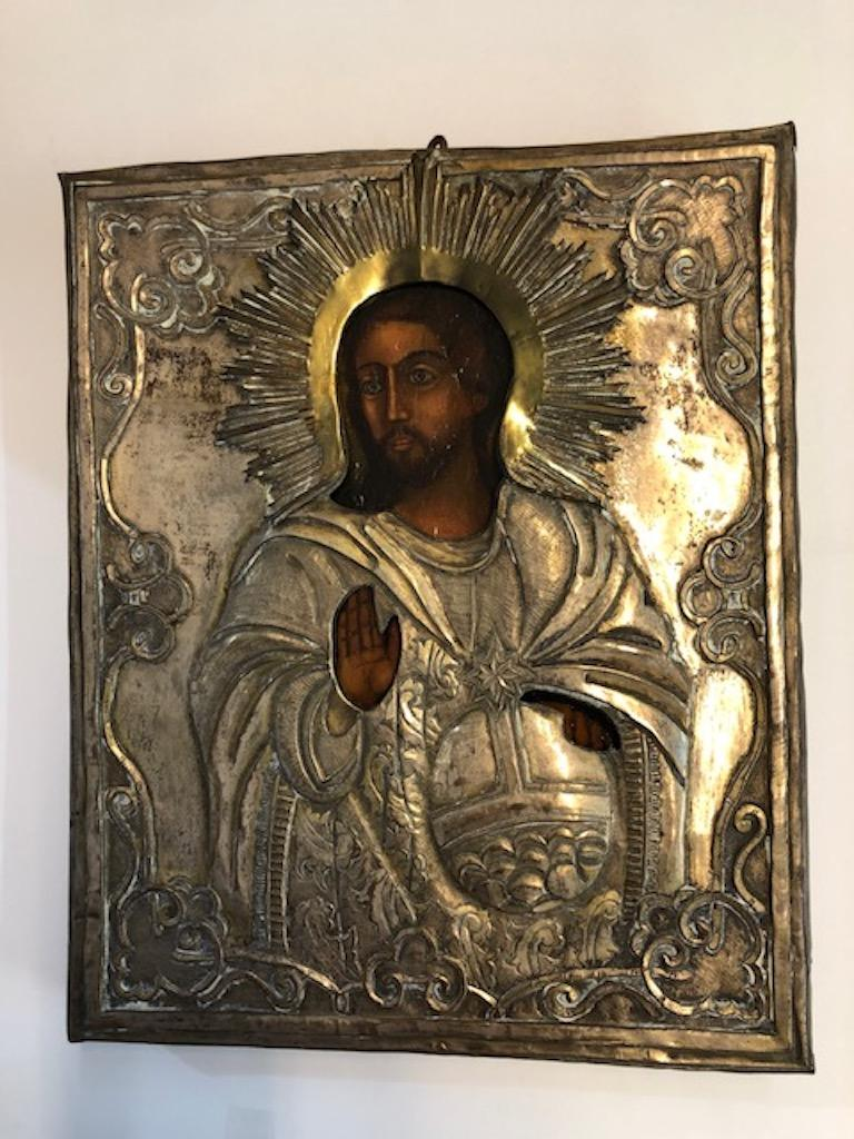 """This impressive icon is encased in a metal oklad (?????) with Riza (????) as the halo around christ's head. Oklad means """"covered"""