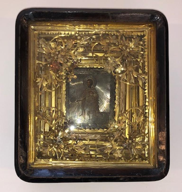 """Russian Icon of Saint Alexander Icon is done with oil paint on the wooden panel, embellished with silver oklad. It is placed in a wooden box (kiot) that is decorated with floral elements made out of gilded silver.    Russia, circa 1870s 3.5"""" W x"""