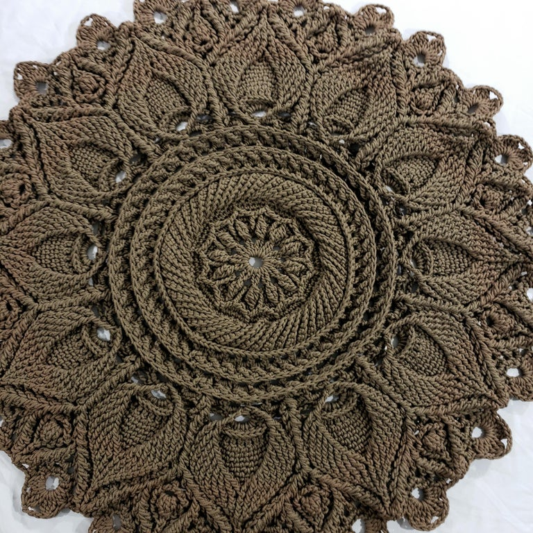 A crochet round mandala rug with layered petals, hand-made with traditional Russian textile techniques.  A modern decoration with the charm and style of vintage carpets. Add an elegant dimension to any room with this luxurious item! ...  52 inches