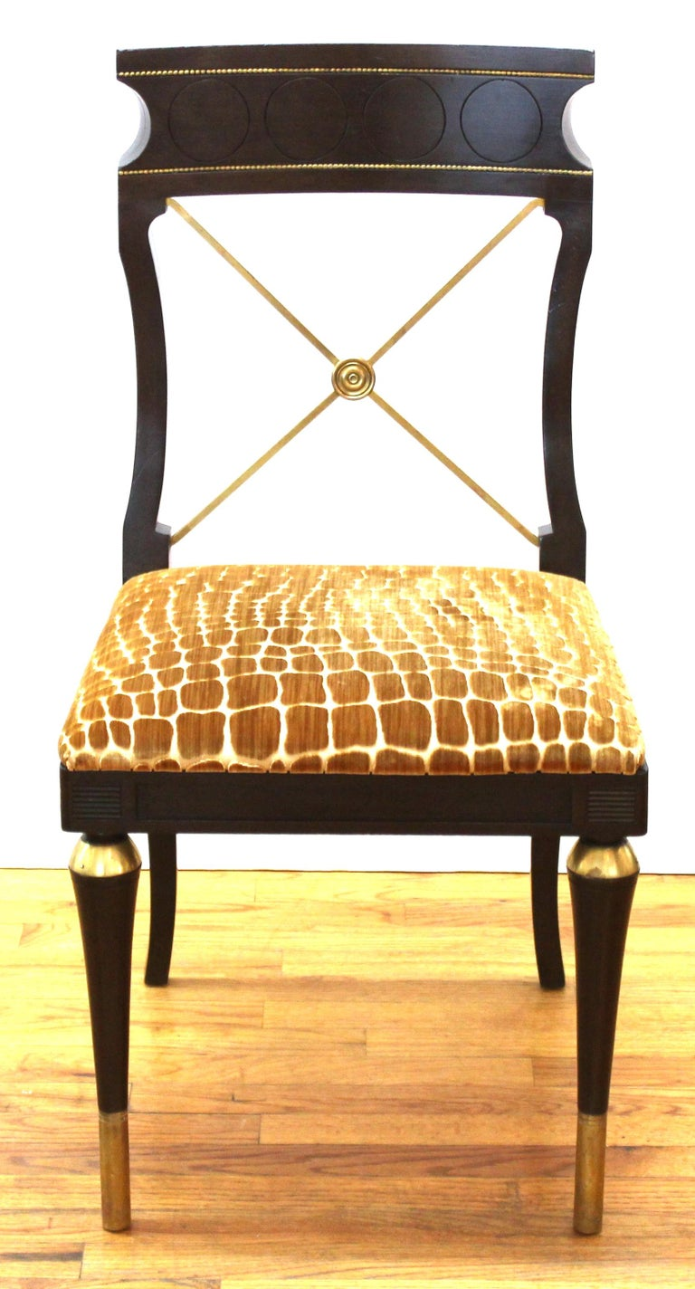 Russian neoclassical or Empire Revival style set of carved wood and metal dining chairs, set of 8, with animal pattern print upholstery. In great vintage condition with age-appropriate wear and use. From the Estate of designer, model, television