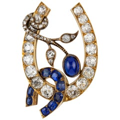 Russian Sapphire and Diamond Horse-Shoe Brooch