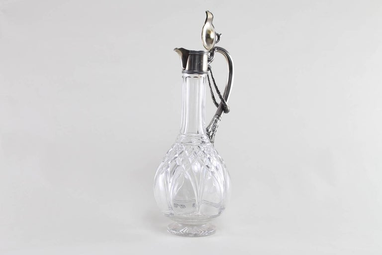 Russian silver mounted claret jug with cut-glass. The silver has a gilt interior, inscribed NS, 29 of April 1942, maker HC and marked 84, small chips on glass, circa 1900.