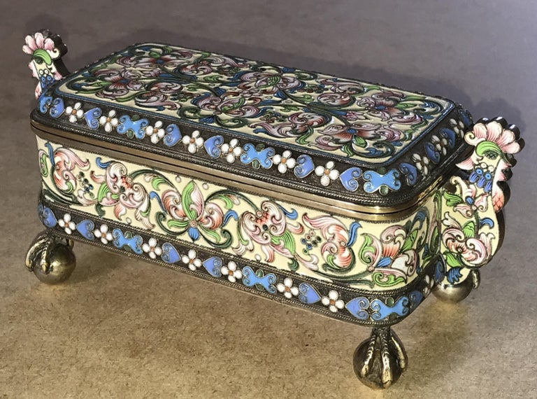 We are delighted to offer for sale this stunning and very rare full sized Imperial Russian 1891 Cloisonné enamel casket box made from solid silver with gold gilding by the highly coveted Pavel Ovchinnikov whilst he worked with Ivan Khlebnikov