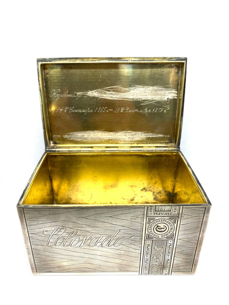 Product details:  Circa 1900. Featuring 84 Russian sterling silver collectable and decorative Tabaco box with outer engraved detail and inscription detail inside. Stamped with 84 and Cyrillic makers mark Г. К. (G.K.). Total weight is 442.7 grams.