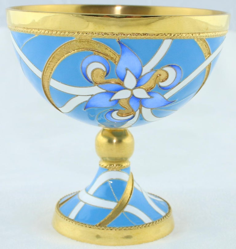 Unique Wine Chalice or Goblet from Russia This is a Russian Revival Chalice or Goblet By Russkiye Samotsvety The Chalice is Sterling Silver 925 The Chalice is plated with 24K Yellow Gold It is adorned with Hot Enamel in Light Blue And White The