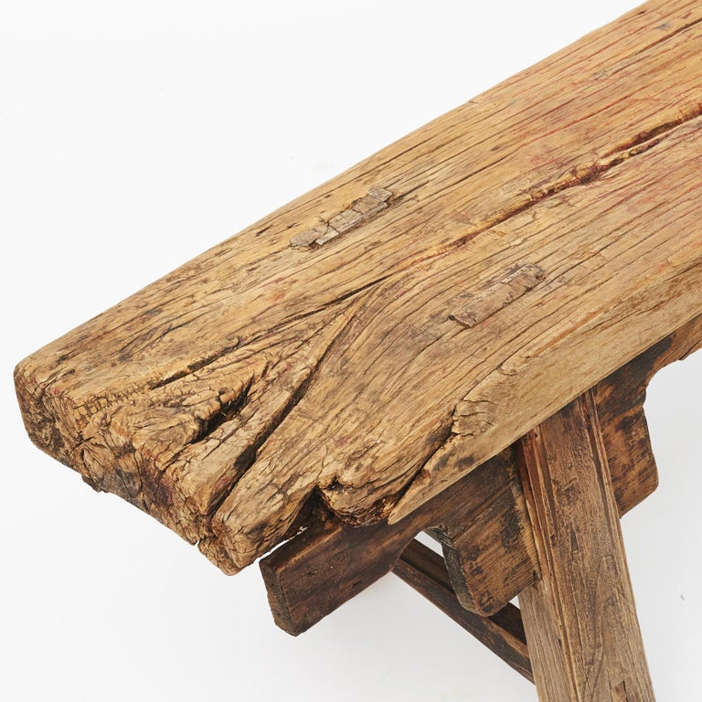 17th-18th century Chinese pine bench. Seat one-piece of wood. Original condition, time has given the bench a very cool rustic look with a raw finish. From Shanxi Province, China.