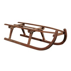Rustic 19th Century French Wooden Sled with Weathered Patina and Curving Base