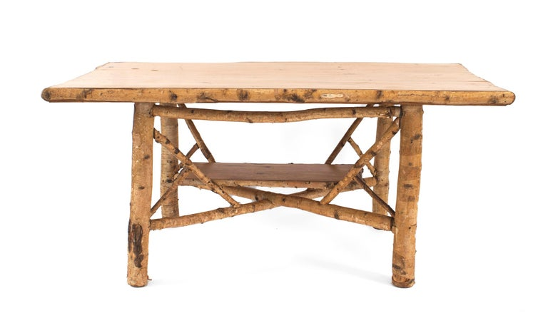 Rustic Adirondack (First half of the 20th century) rectangular birchwood dining table with stretcher base and blond wood plank top trimmed with birch.