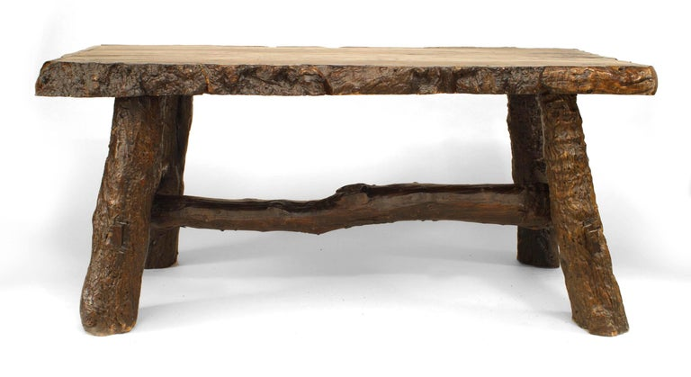 Rustic American Adirondack style 20th century walnut rectangular top dining table with bark trim edge and tree trunk from legs and stretcher.