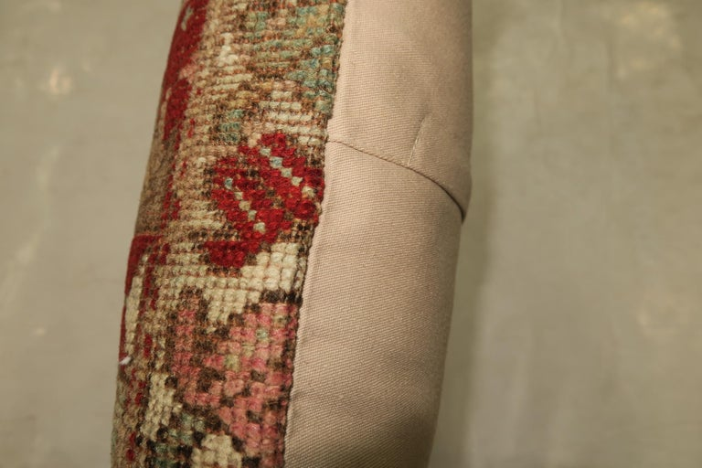 Lumbar size pillow made from a 19th century tribal Caucasian rug in soft blue and red.  Measures: 16