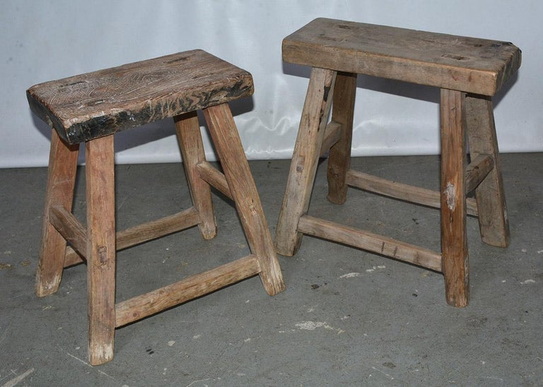 The rustic Chinese stools are crafted with pegged legs that fit into the seats and stretchers that fit into the legs for sturdy construction. Each stool is slightly different in shape and size since these are all handmade and collected from
