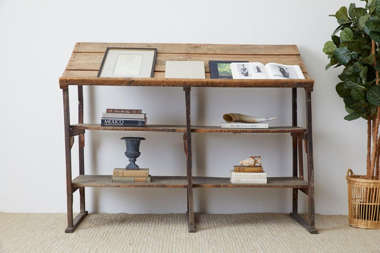 Large early 20th century American rustic three shelf display or étagère. Constructed from weathered pine barnwood with a lovely distressed patina. The open frame holds three shelves with the top set at an angle having a lip on the bottom. Perfect