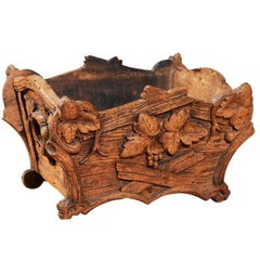 Rustic Black Forest Jardinière with Carved Foliage and Branch Motifs, 1920s