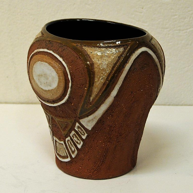 A special mid-century vase made by Hank Keramikk Verksted in Oslo, Norway established by Ahlberg & Karlsen keramikkverksted in the 1950s. A vintage ceramic vase whith lovely earth colors and nice decor. Most of the Hank ceramic items were richly