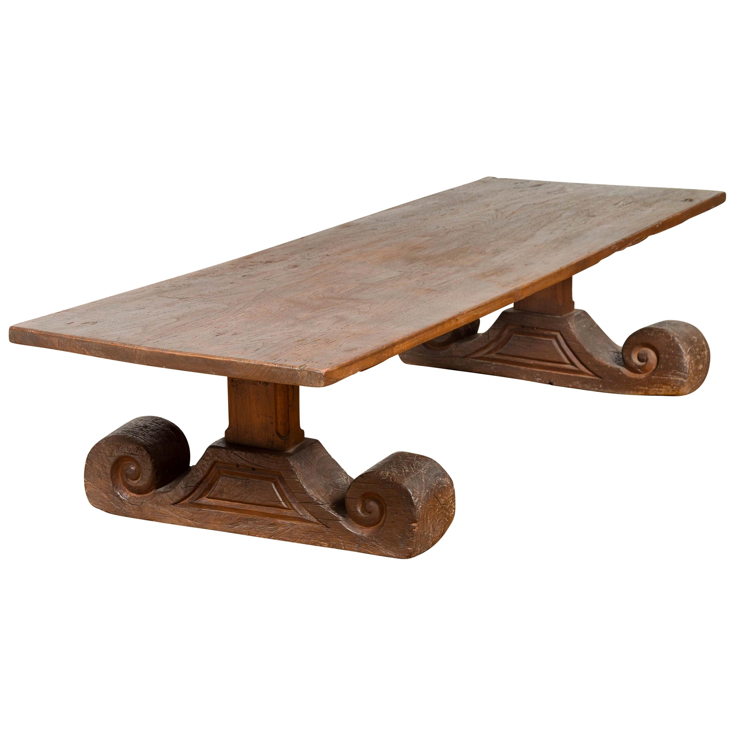 Rustic Chinese 19th Century Elm Coffee Table with Large Scrolling Feet