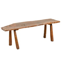 Rustic Driftwood Bench with Weathered Appearance and Splaying Legs