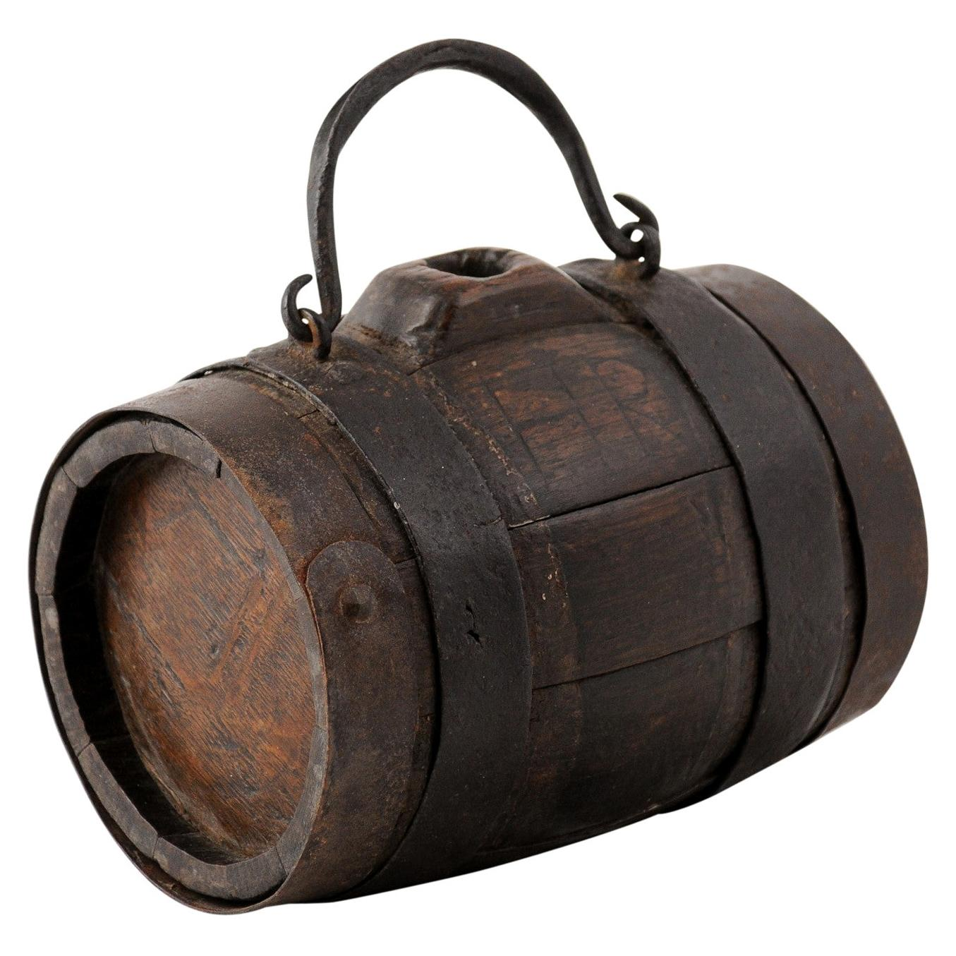 Rustic French 19th Century Petite Decorative Barrel with Iron Handle and Braces