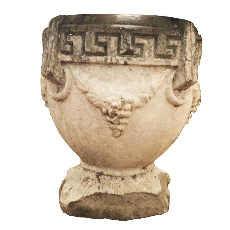 Concrete urn garden planter. Featuring Greek key around the top of the planter. And grapes surrounding with figural round handles. Approximately 100 lbs each. Some minor losses around the base, but still very sturdy.