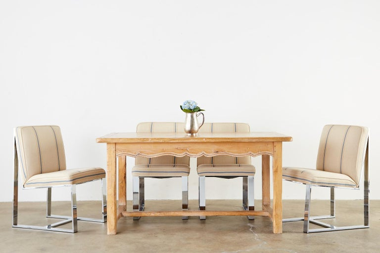 Rustic pine farmhouse dining table or trestle table featuring two large extending leaves. Each leaf measures 20 inches and extends the farm table to 100 inches (60 inches without leaves). Constructed from thick 1.5 inch planks of wood with the top