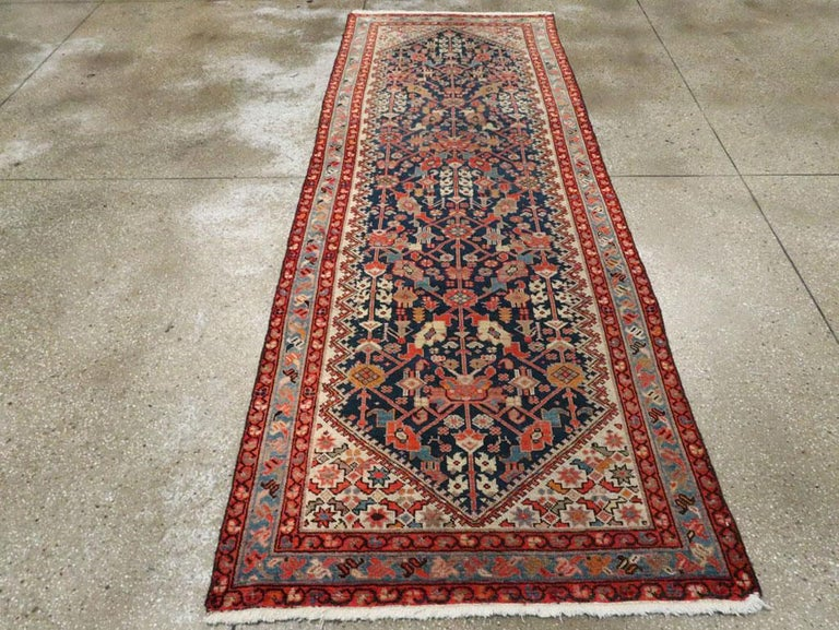 Rustic Handmade Persian Runner in Navy, Red, Ivory, and Light Blue In Good Condition For Sale In New York, NY