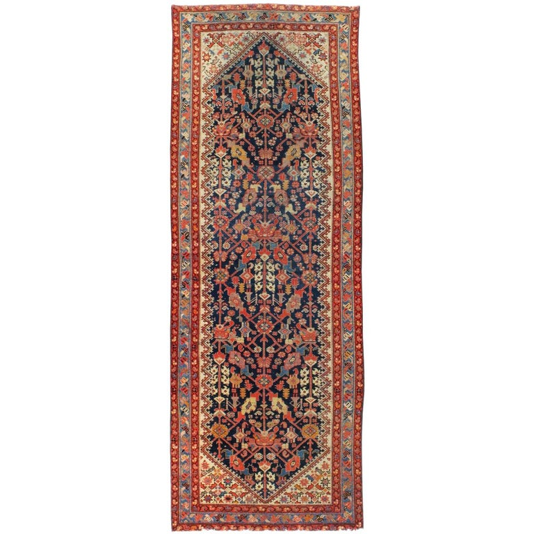Rustic Handmade Persian Runner in Navy, Red, Ivory, and Light Blue For Sale