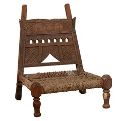 Rustic Indian Low Wooden Chair with Rope Seat and Weathered Appearance