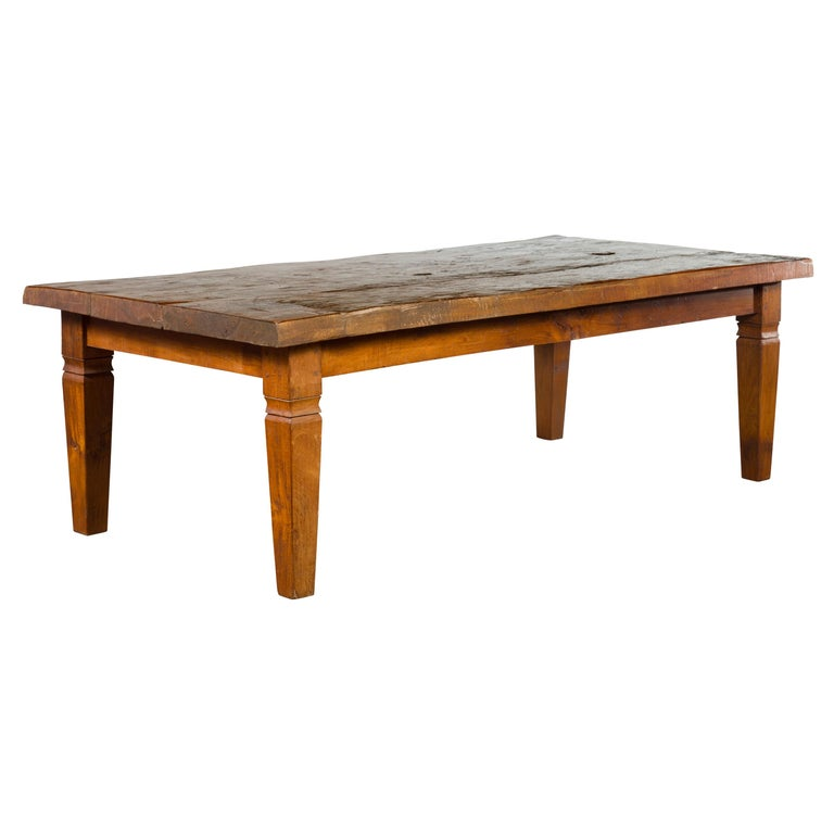 Rustic Indonesian 19th Century Coffee Table Made from a Slab of Wood For Sale