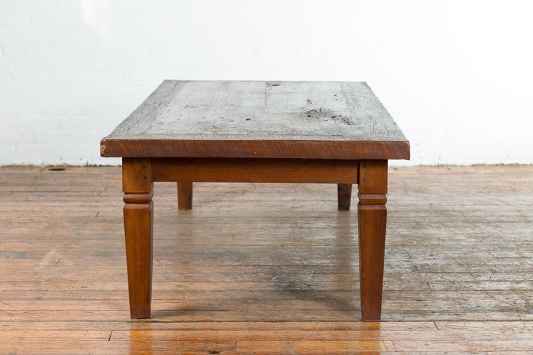 Rustic Indonesian 19th Century Coffee Table with Tapered Legs For Sale 8