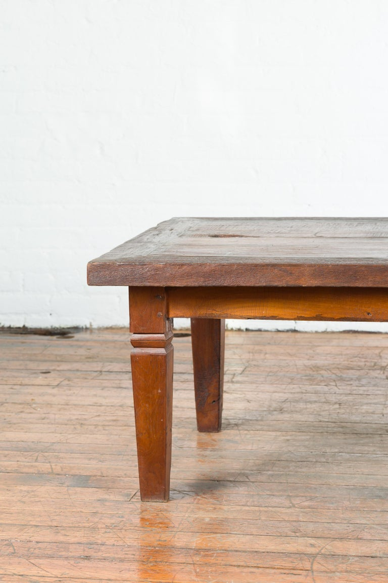 Wood Rustic Indonesian 19th Century Coffee Table with Tapered Legs For Sale