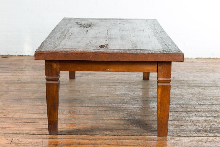 Rustic Indonesian 19th Century Coffee Table with Tapered Legs For Sale 5
