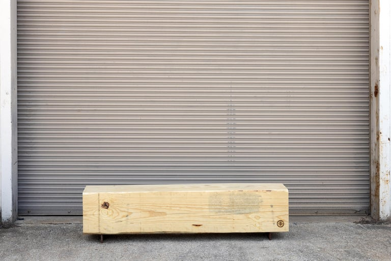 Our beam bench utilizes salvaged local pine logs for a rustic bench for indoors or outdoors. Narrow and backless, the simple lines express the natural texture of the end grain of each species. The 15